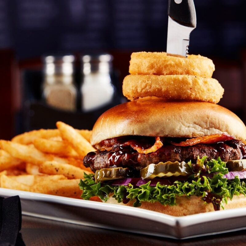Burger and onion rings from Big Whiskey's American restaurant food menu.