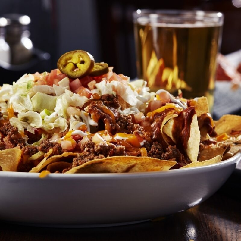 Nachos from sports bar and grill Big Whiskey's local happy hours menu.
